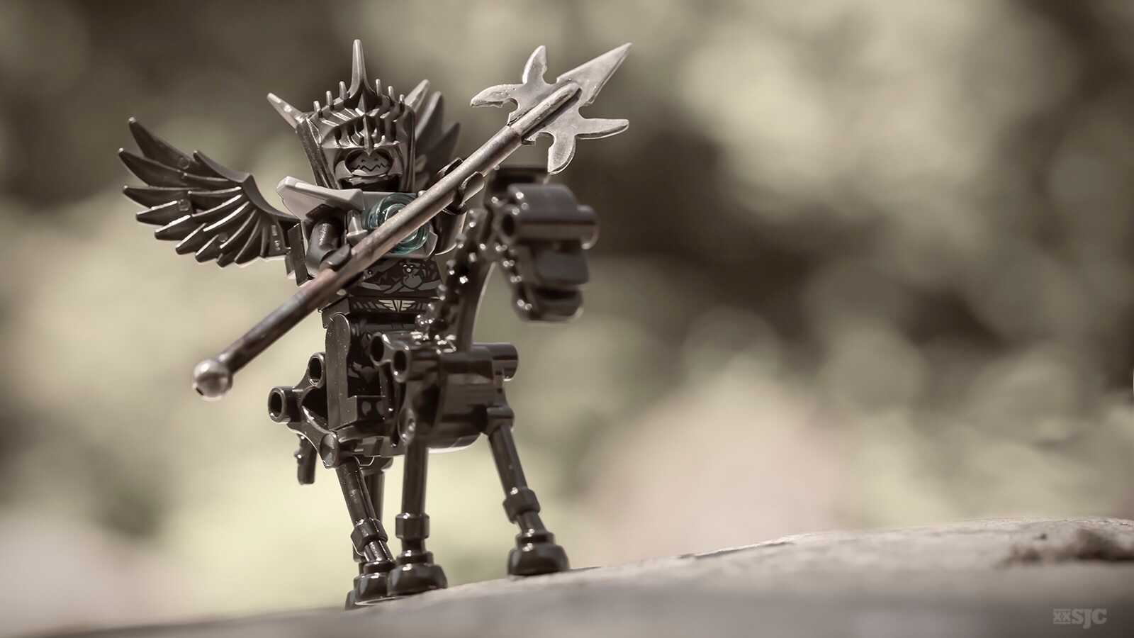 a LEGO black winged angle riding a black skeleton horse wields a large and deadly battle axe