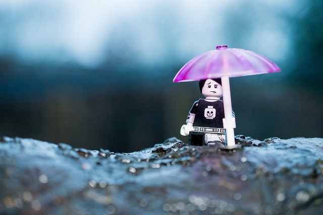 LEGO boy with pink umbrella