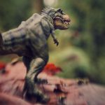 A Papo toy dinosaur rampages across the landscape. Photo taken by Shelly Corbett with a Lensbaby