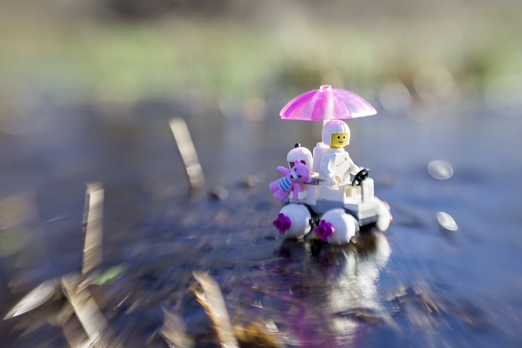 Lego space explorer with pink umbrella taken with a Lensbaby by Shelly Corbett