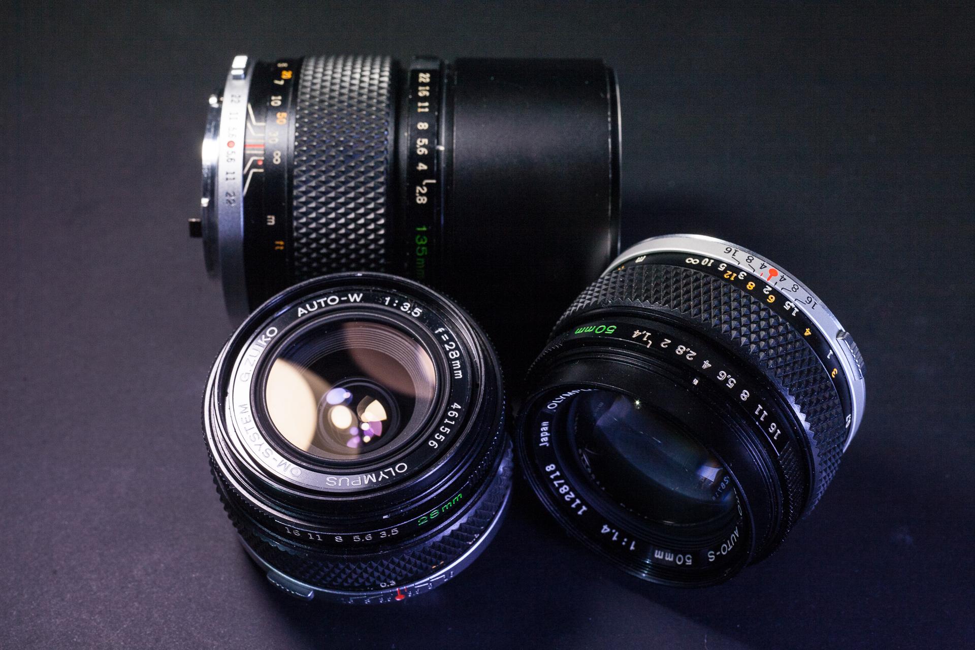 Zuiko 28mm f3.5, 50mm f1.4, 135mm f2.8