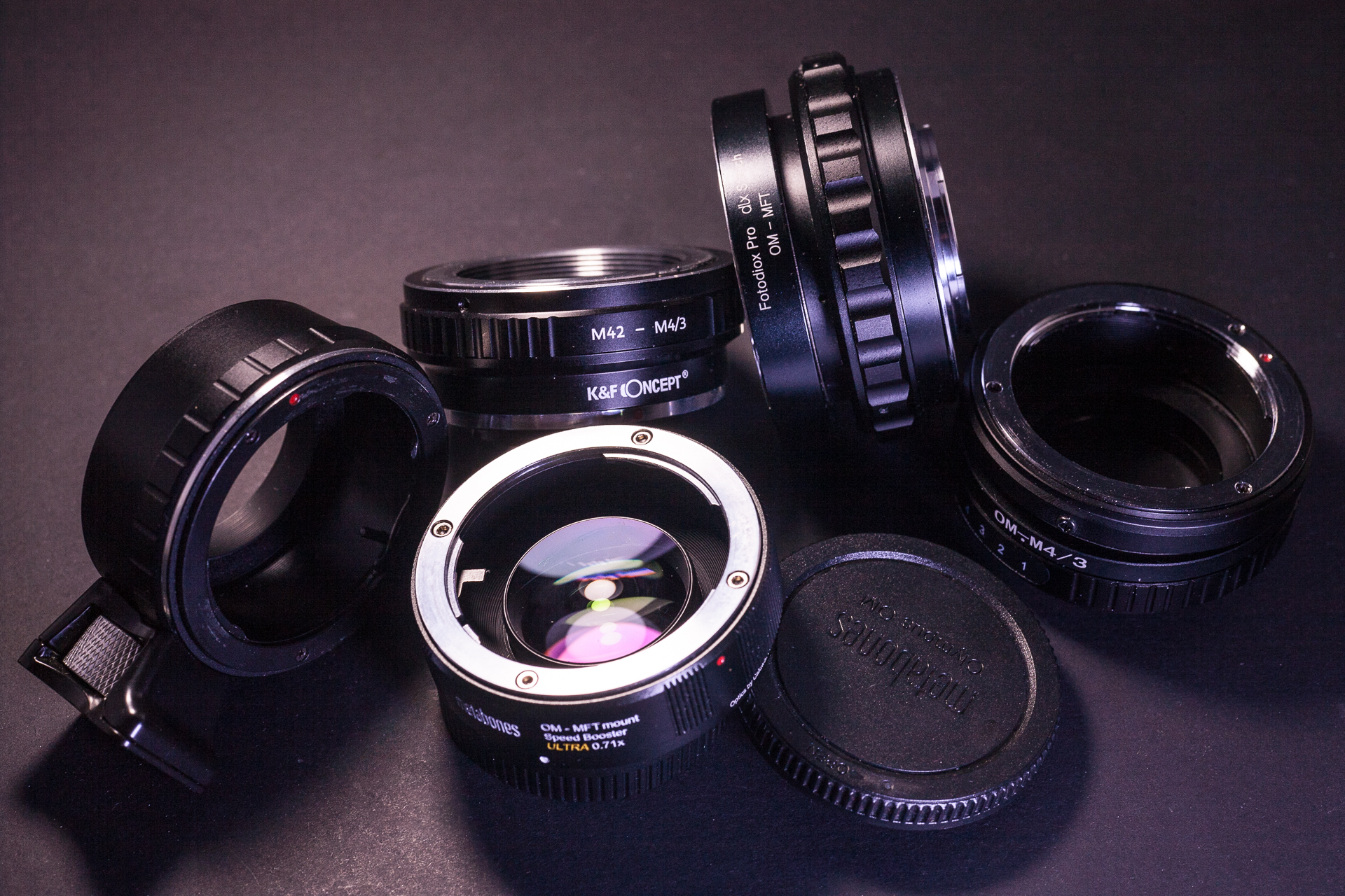 A selection of MFT adapters - tripod, screw mount, helicoid, shift, focal reducer