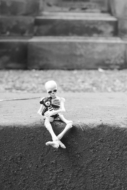 Pose skeleton hugging a LEGO teddy bear