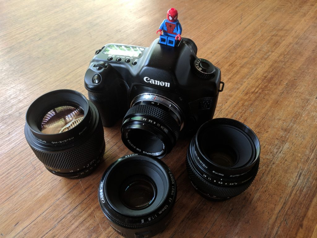 Canon 5D with a selection of legacy lenses and an EF 50mm f1.8