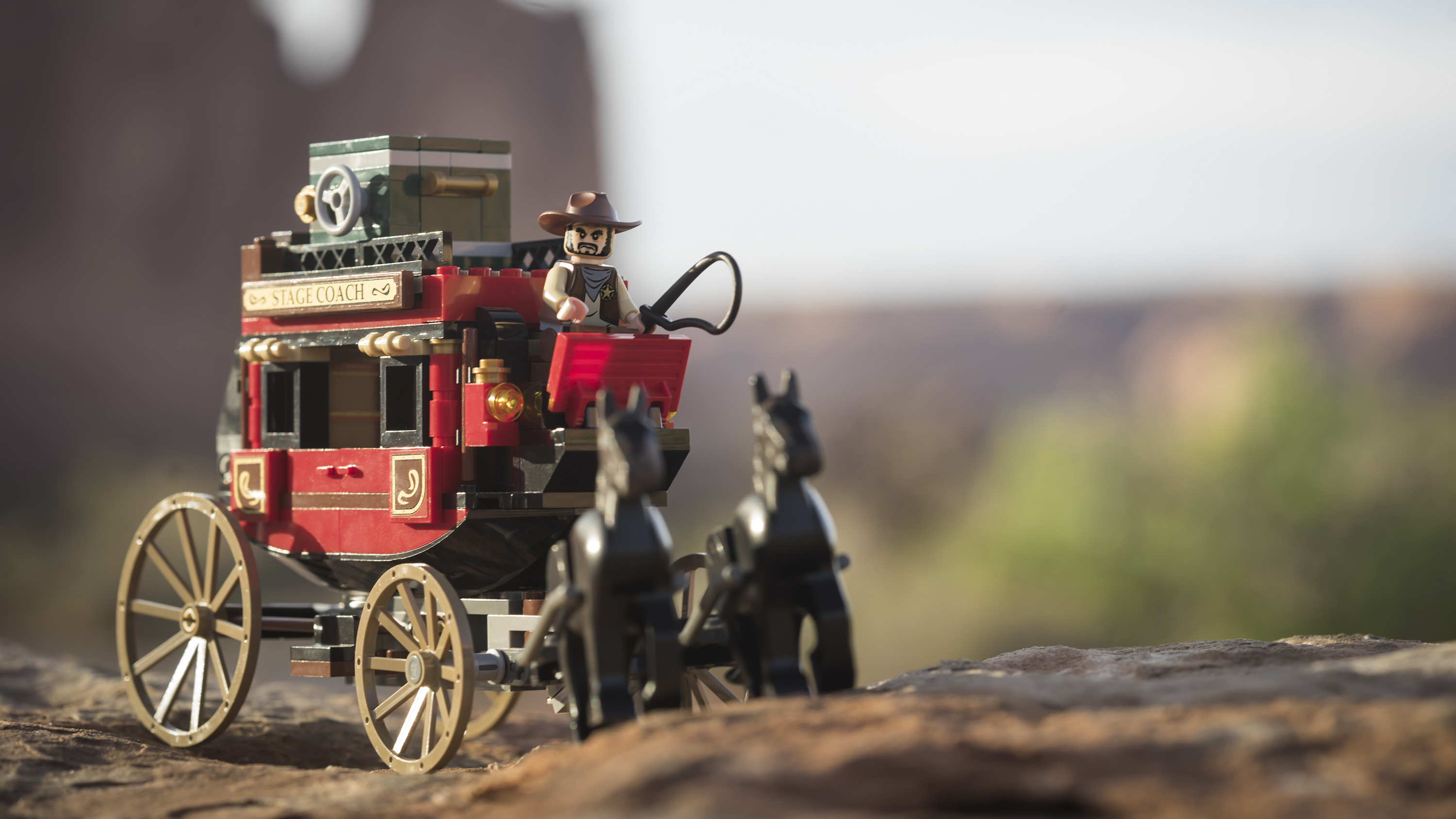 LEGO stage coach and two lego horses in the fading light of Arches NP, Utah