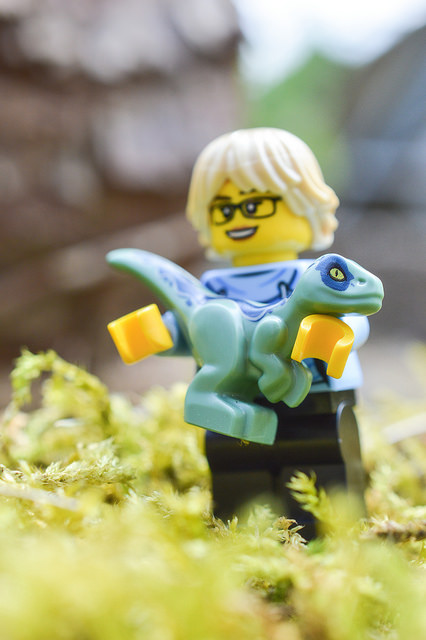LEGO figure with baby dinosaur