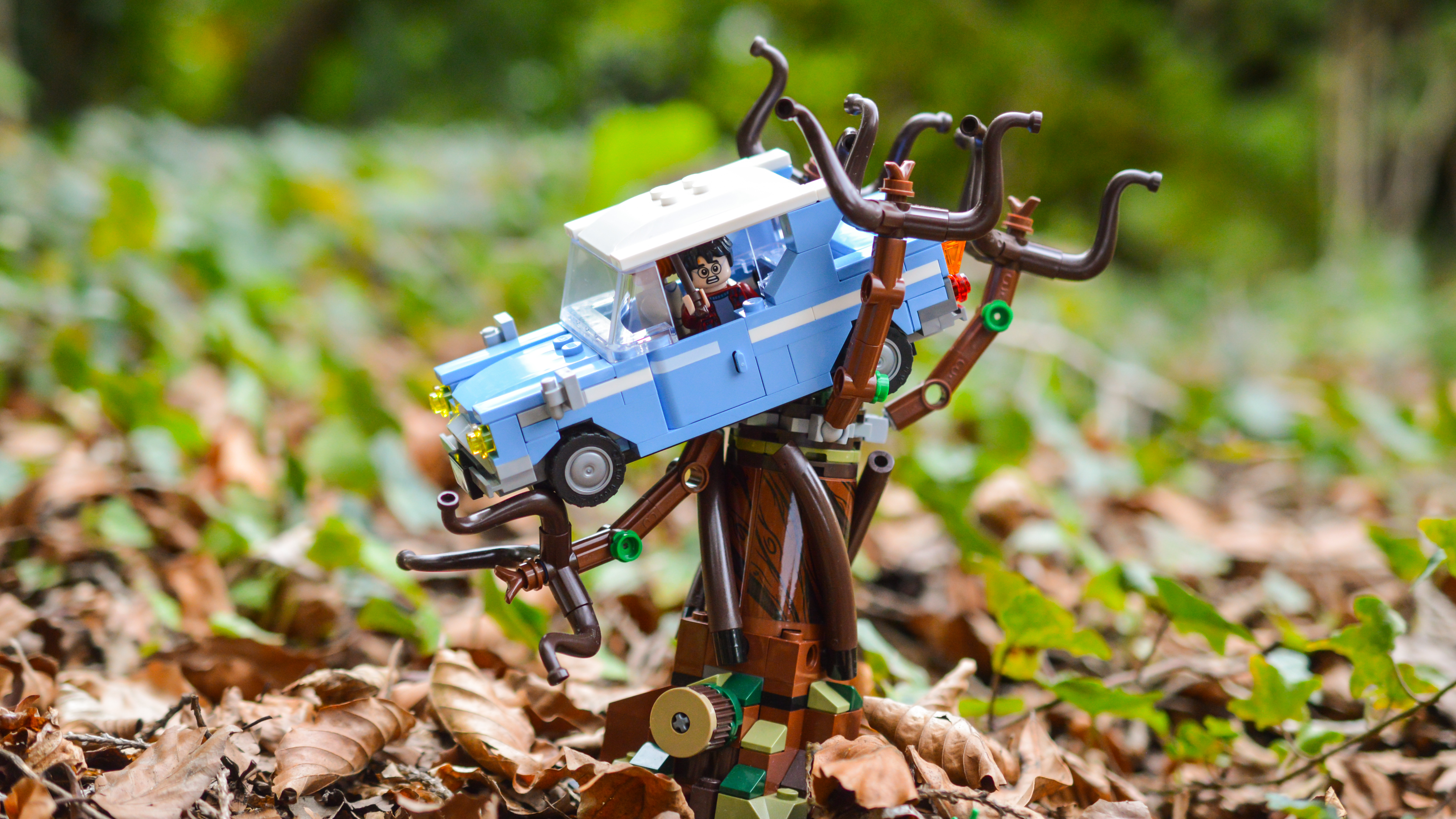 LEGO Ford Anglia sitting in Whomping Willow