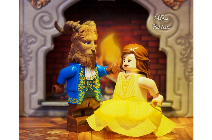 Beauty and the Beast are dancing in the castle