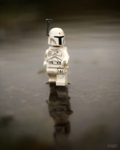 The Prototype Bob Fett walks on water proving that he is indeed a god in this grey, dark, atmospheric outdoor toy photography.