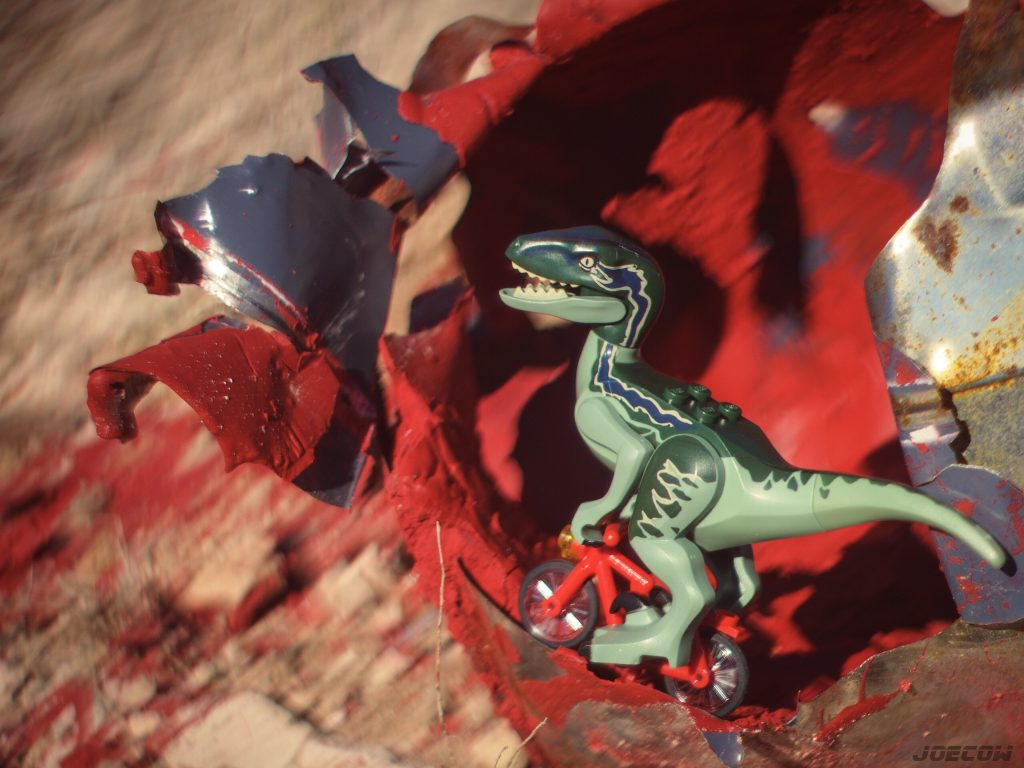 a lego raptor on a bike surrounded by red