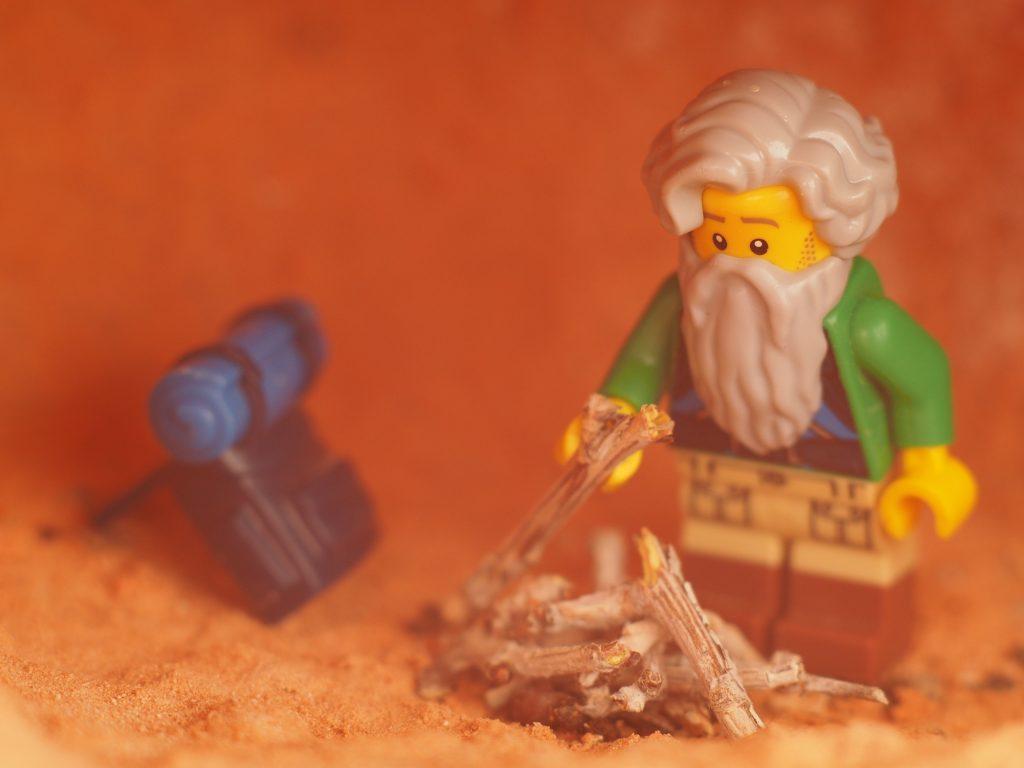 Jim preps wood for a campfire
