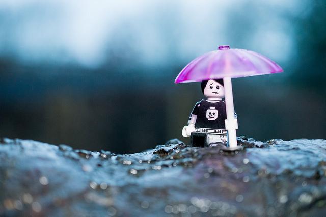 LEGO boy with pink umbrella