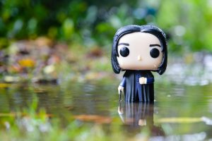 Pop figure 'Snape' in a puddle