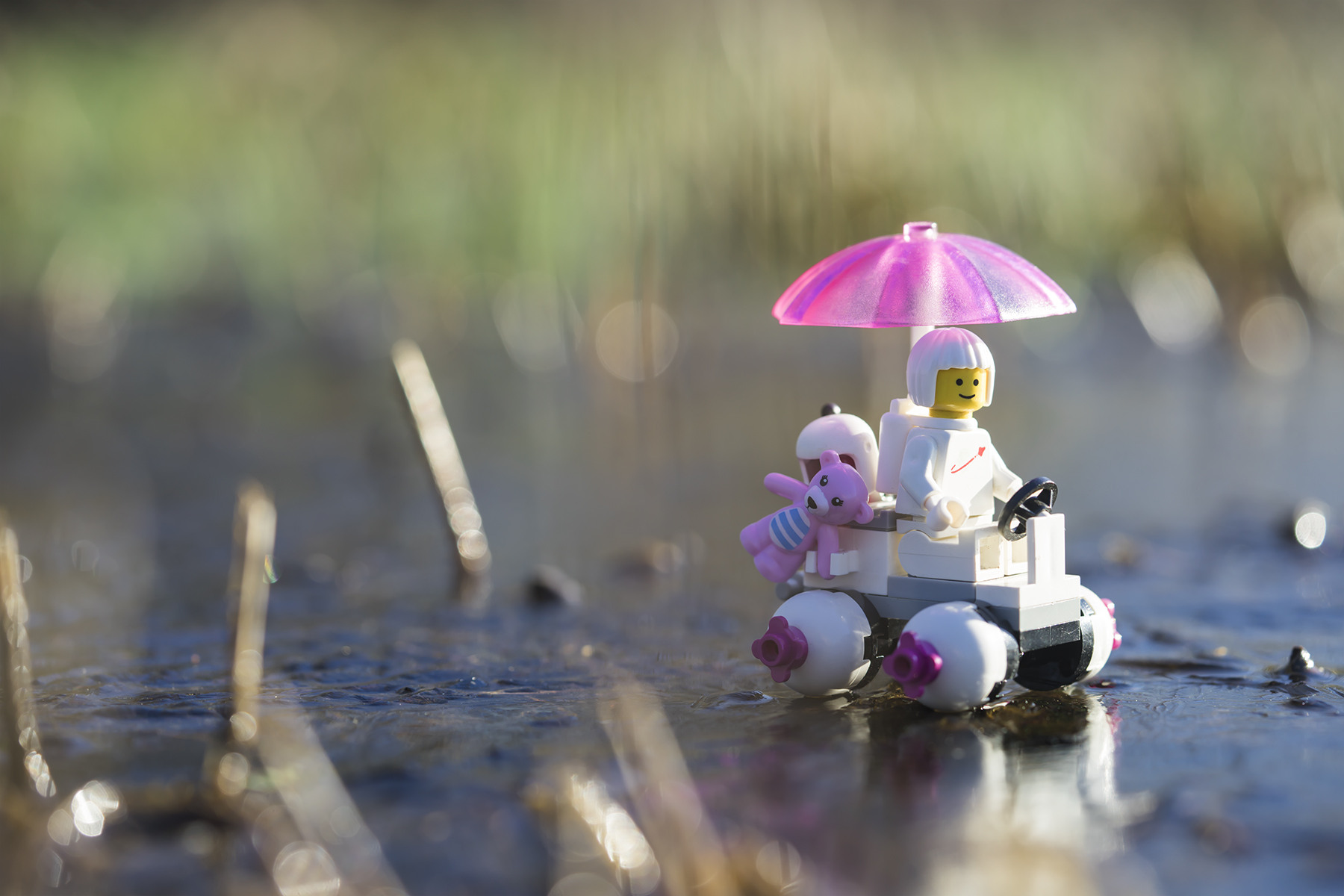 Lego space explorer with pink umbrella taken with a Sony 90mm macro lens by Shelly Corbett