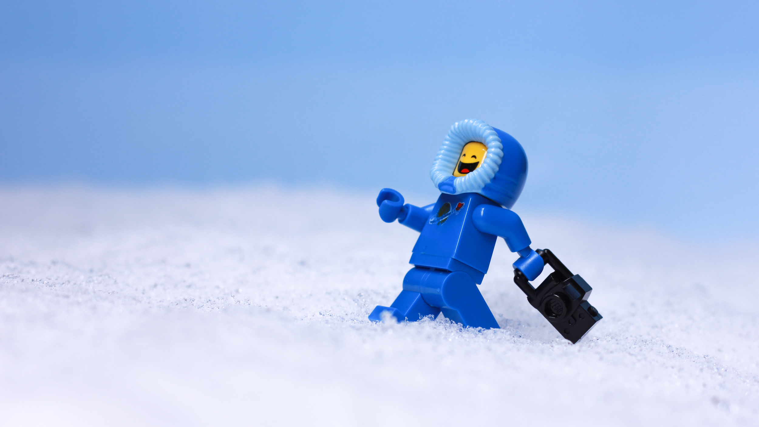 blue LEGO benny spaceman holds camera by James Garcia