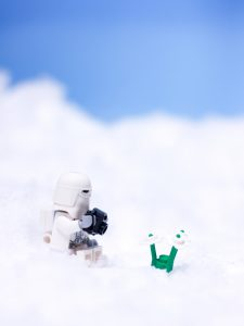 Lego Star Wars Snowtrooper with camera and flower in snow by James Garcia
