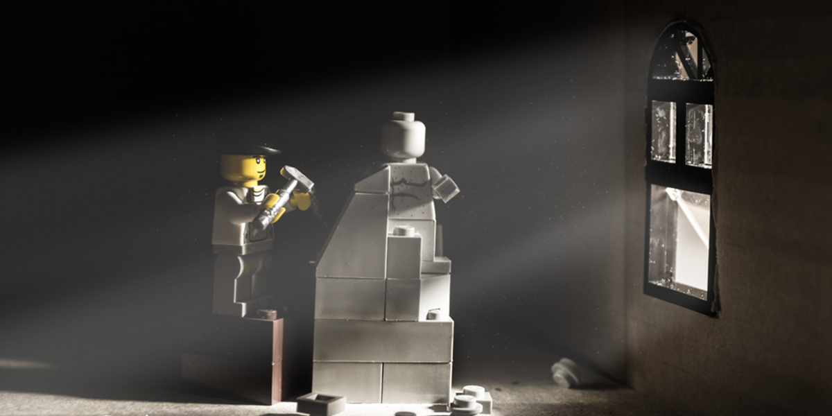 LEGO figure creating a sculpture