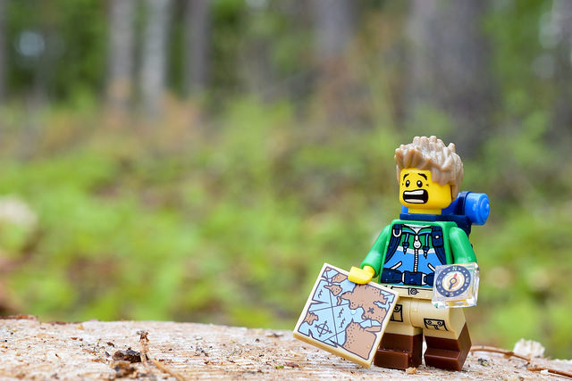 LEGO hiker figure in the woods