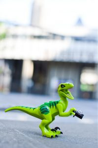 LEGO dinosaur playing tourist in London