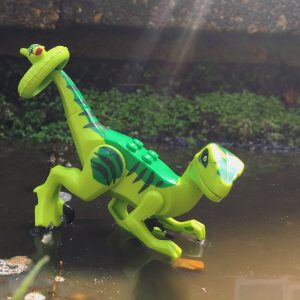 LEGO dinosaur in a puddle