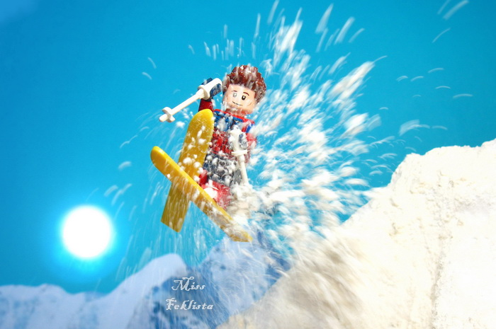Jumping skier with snow splashes
