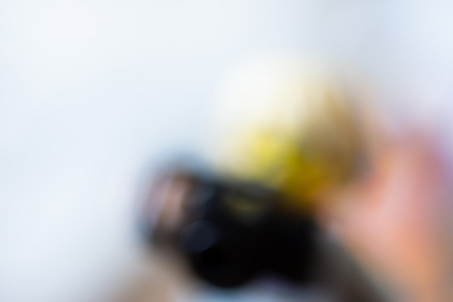 A very blurry photo of a LEGO figure with a camera