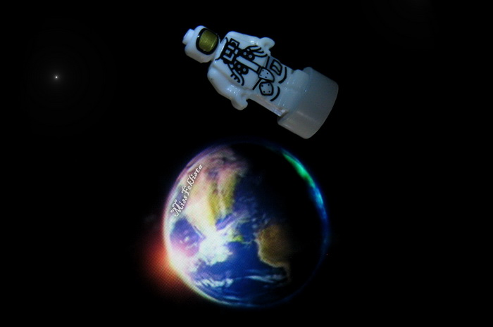 The astronaut with a holographic Earth