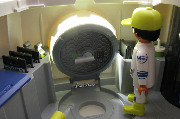 The Astronaut is opening the door of the Space Station