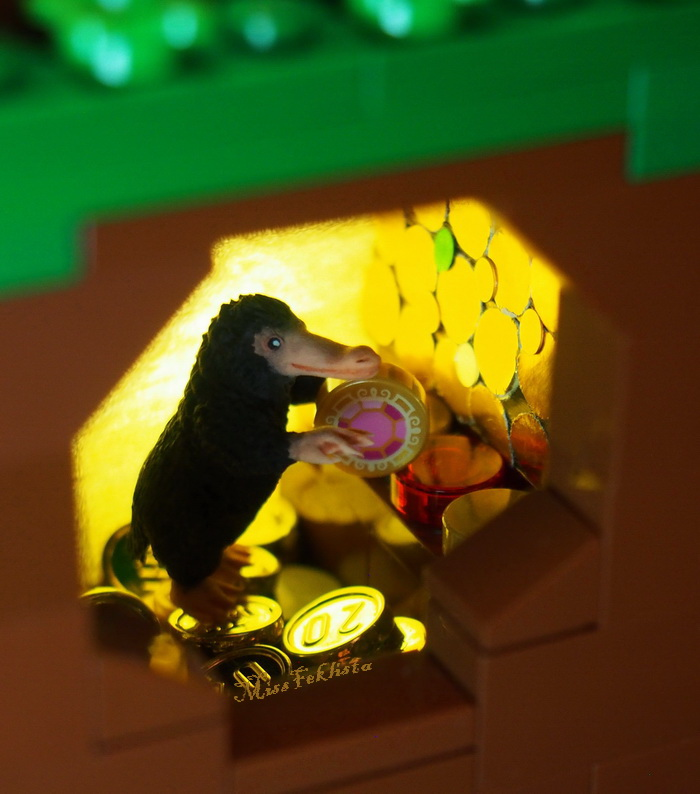 The Niffler in its house with gold