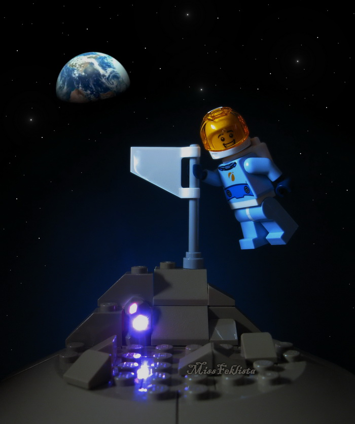 The future astronaut is walking on the artificial moon surface