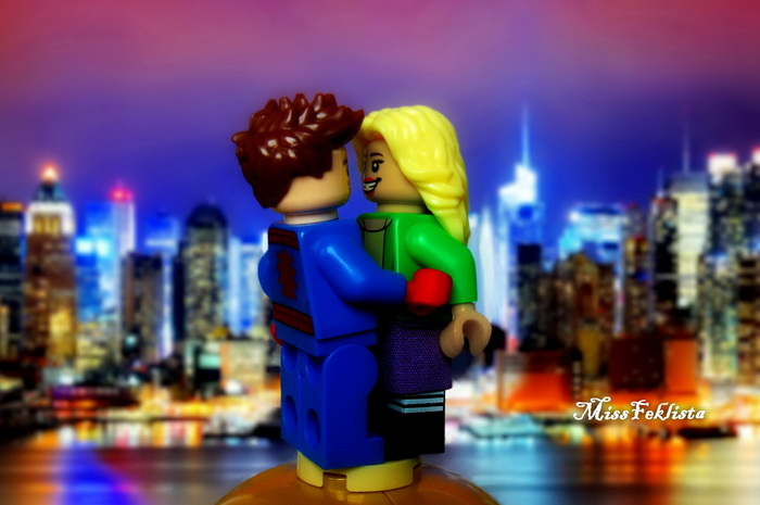Peter Parker and Gwen Stacy on the roof near the river