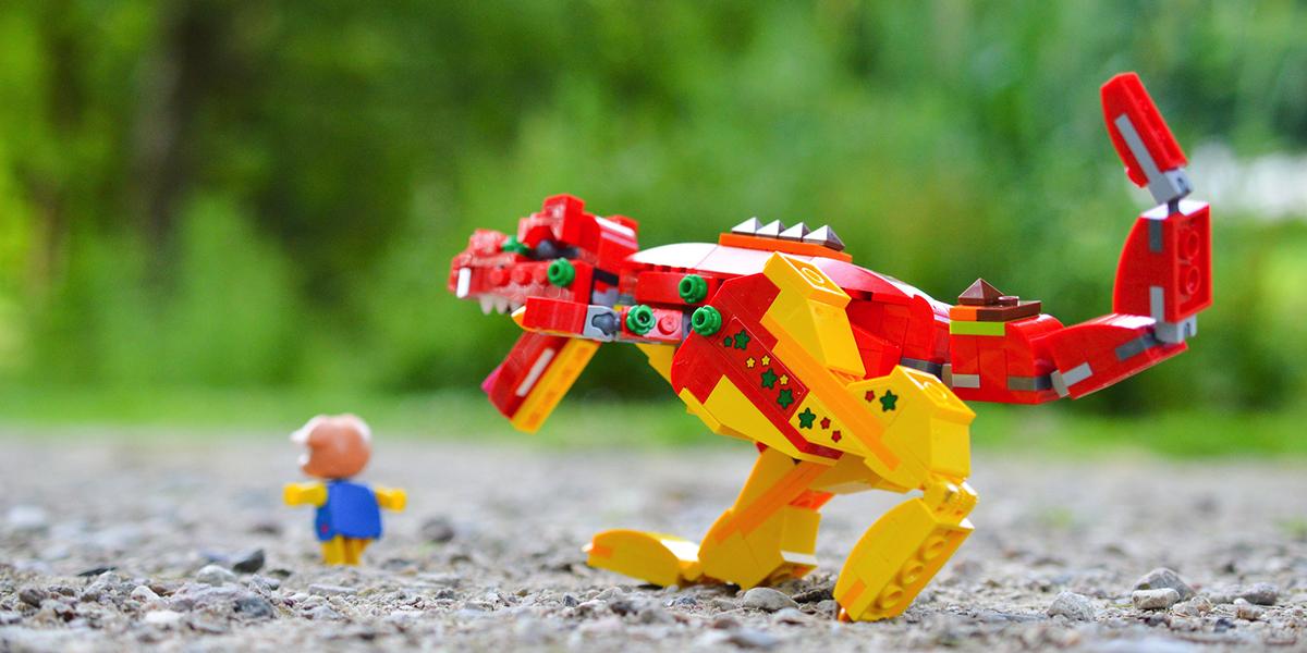 LEGO dinosaur chasing piggy