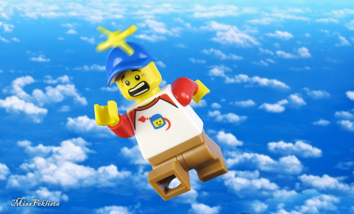 The boy is flying with his propeller hat