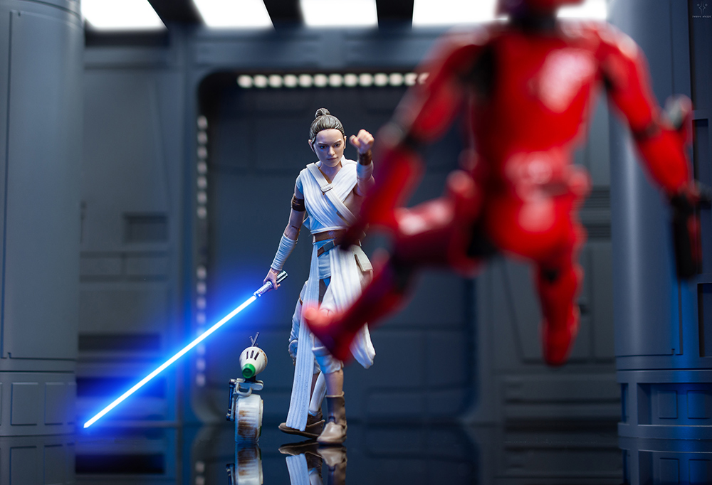 Star Wars the Black Series Rey Force pushes a Sith trooper action figure from The Rise of Skywalker