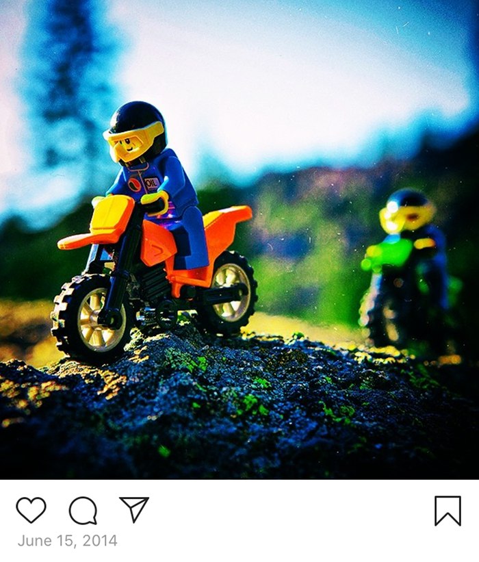 LEGO Minifig motorcyclist and riding buddy on a rocky ridge