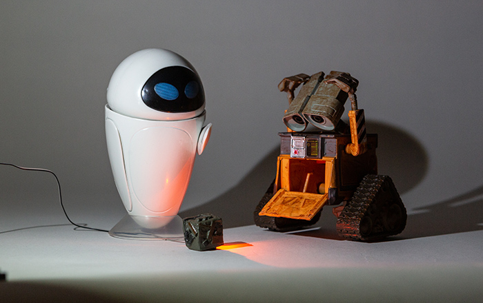 Wall-E and Eve lit with two flood (cool white) Just Plug LEDs from the left and one orange pin LED.