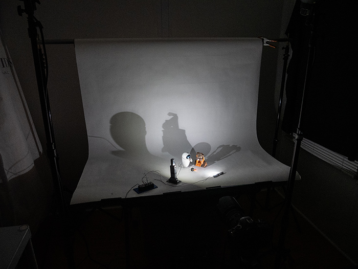 Overall BTS image showing a light-controlled environment.