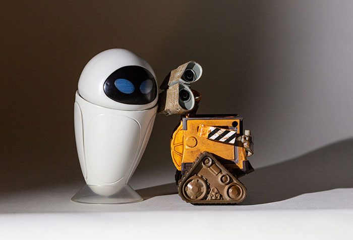 Wall-E and Eve lit with a single Lume Cube and barndoor set for the light fall-off just behind Eve.