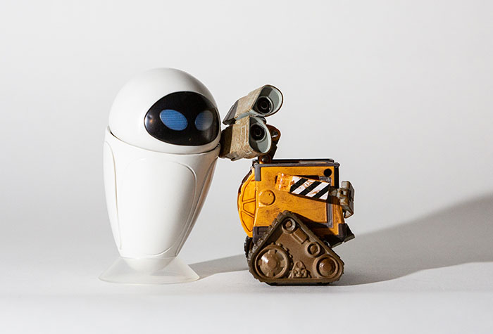 Wall-E and Eve lit with a single Lume Cube and frosted globe modifier.