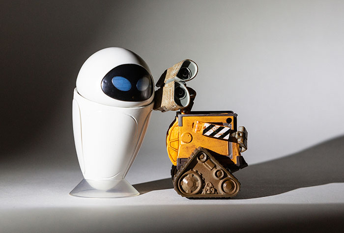 Wall-E and Eve lit with a single Lume Cube and snoot centered on them.
