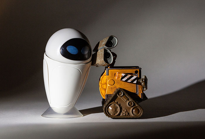 Wall-E and Eve lit with a single Lume Cube with a tight grid and snoot centered on them.