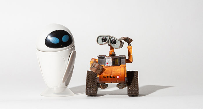 Wall-E and Eve lit with a speedlight and modifier