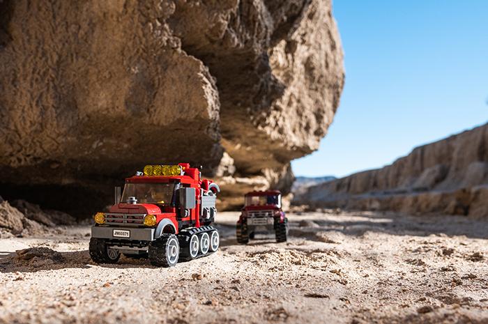The adventurers begin their journey in Lego trucks.
