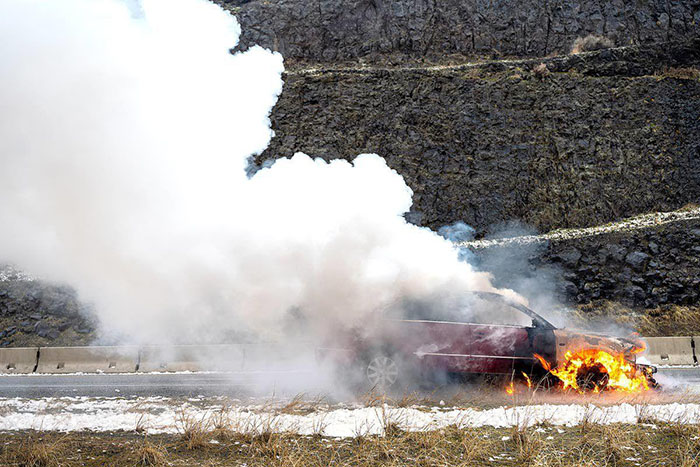 Car burning with smoke and fire