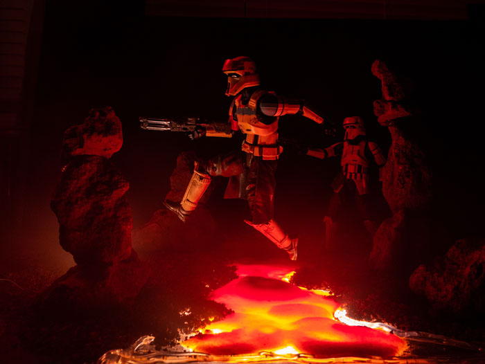 Scarif trooper action figure leaping over the lava.