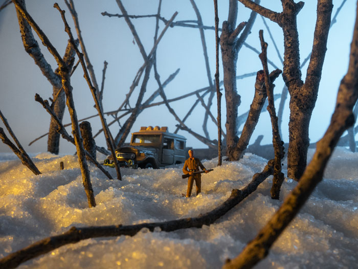 A hunter in the emerging pre-dawn light. HO Scale.