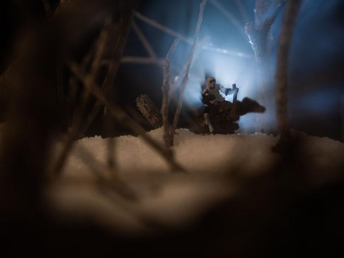 Speeder bike miniature zooming through the woods