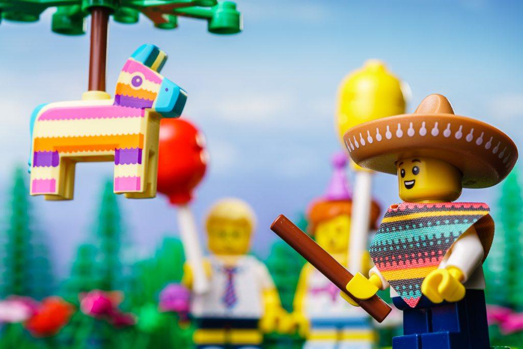LEGO CMF Series 20 - Piñata Boy swinging at a Piñata