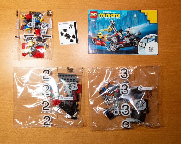 Three bags, one small sticker sheet and instruction manual