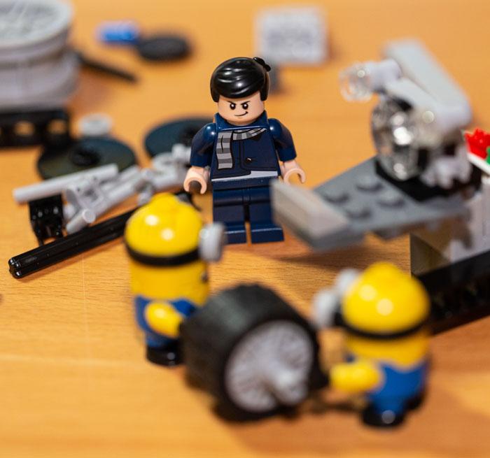 Gru supervising the Lego Minions.